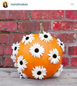 picture of a pumpkin with flowers painted on it
