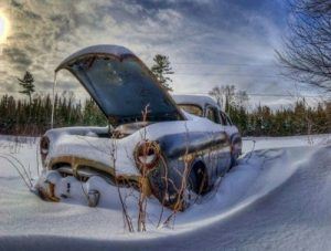 image of a car buried in the snow