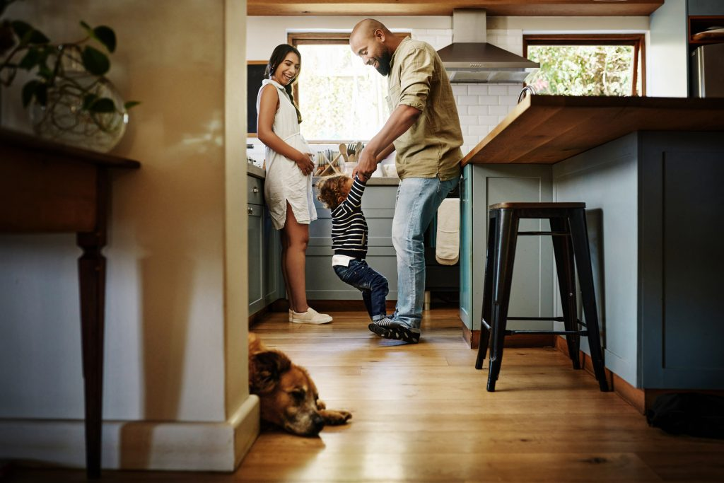 A family and their dog spend time in the kitchen.
