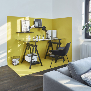 A modern home office with a yellow wall.