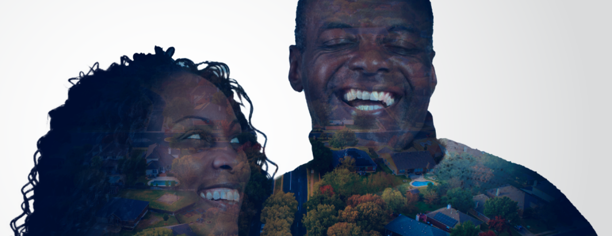 An aerial image of a town is superimposed over a black man and a black woman smiling.