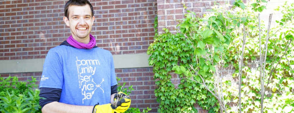 Windermere agent Kyle Craft smiles in the garden.