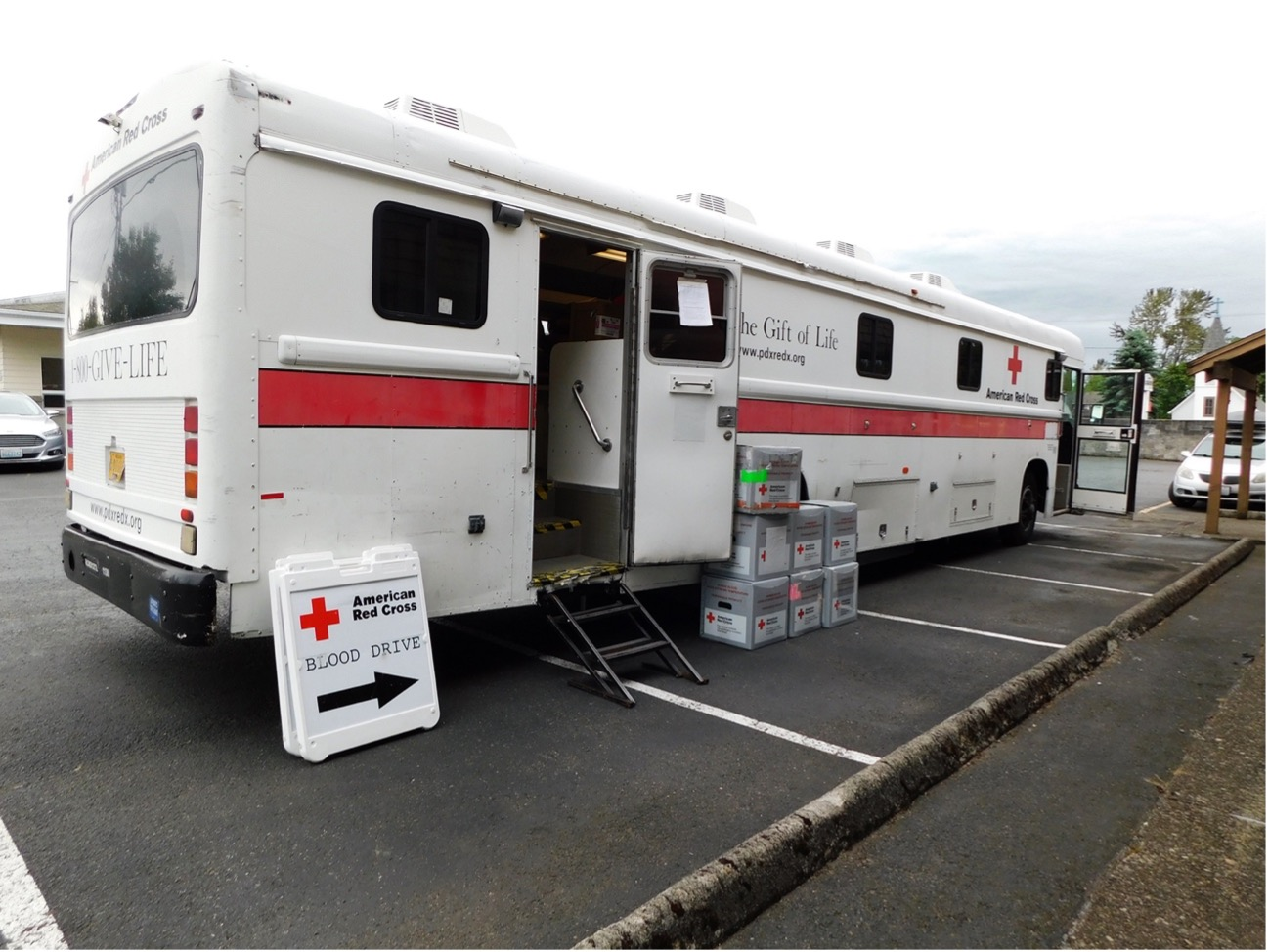 A white American Red Cross truck parked in a parking lot.