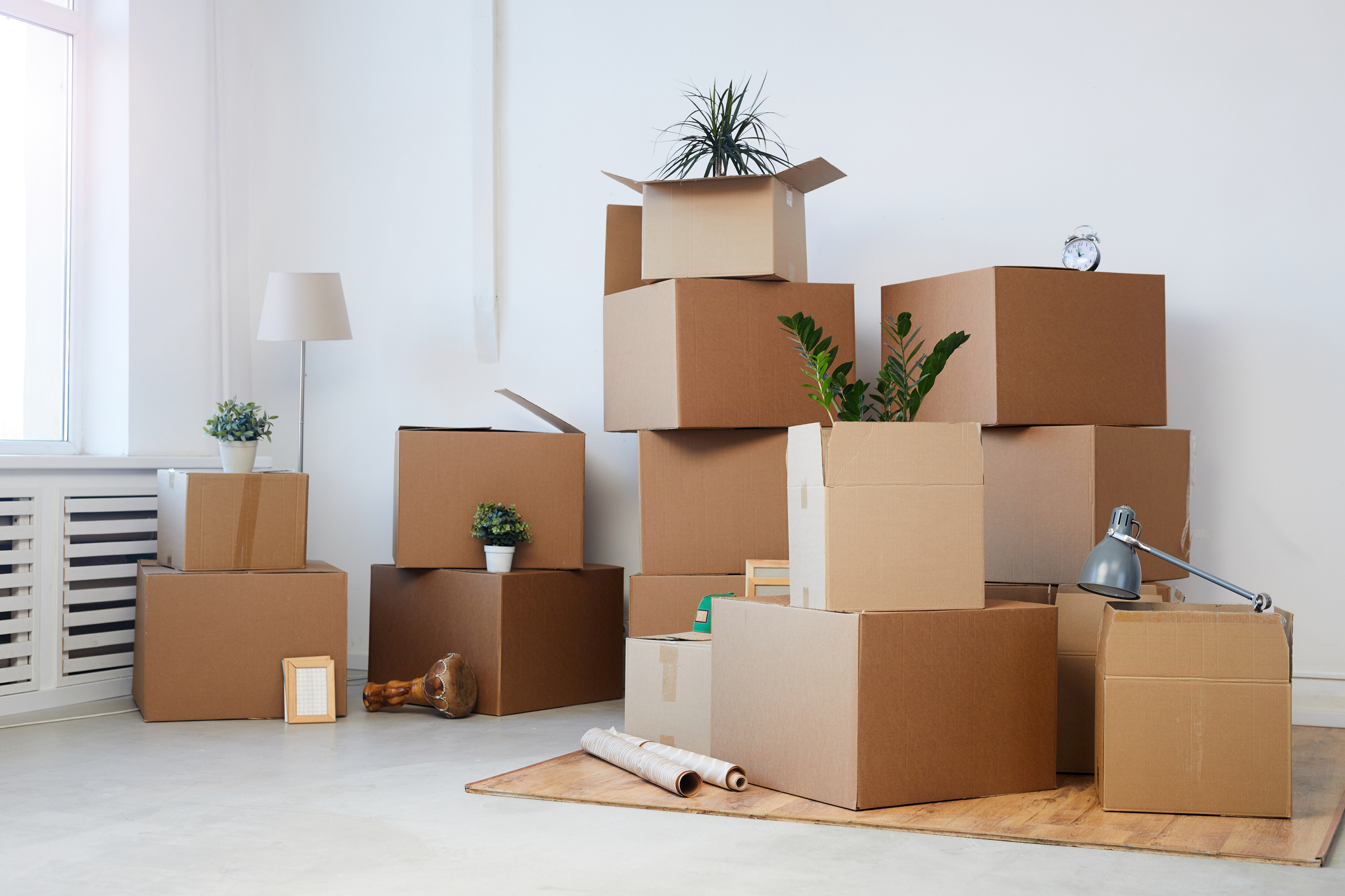 A stack of cardboard boxes in a living room.