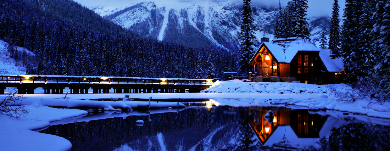 A lake house covered in snow.